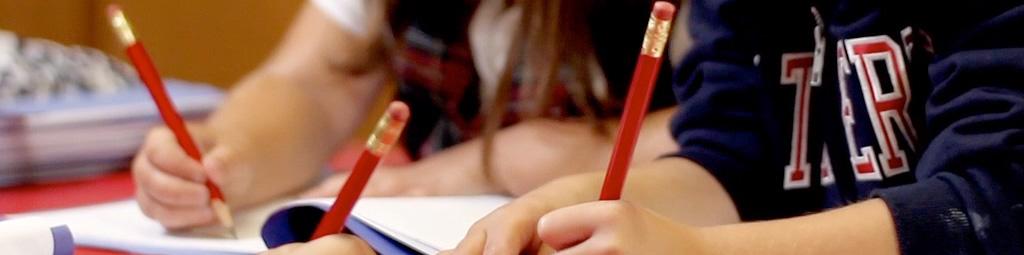 Pencils in students' hands.